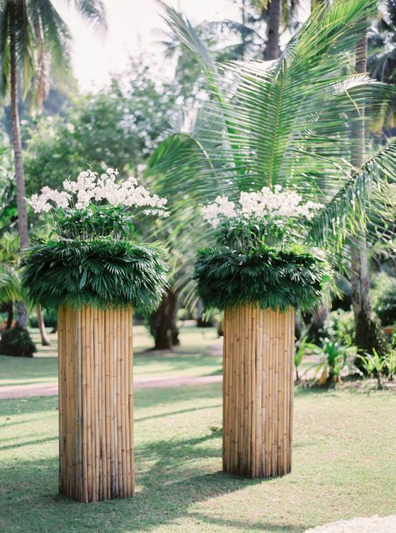 Tall plinth altar flowers for outdoor tropical wedding in Thailand