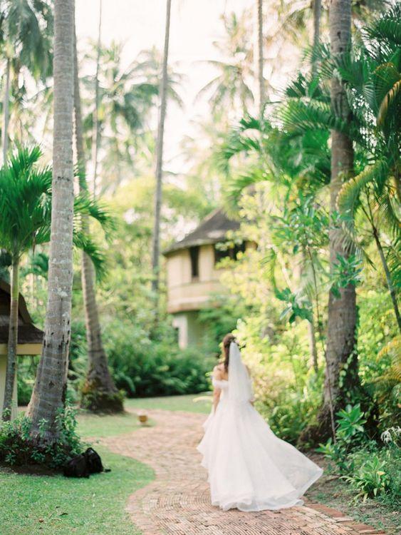 Bride in organza wedding dress at Tropical wedding