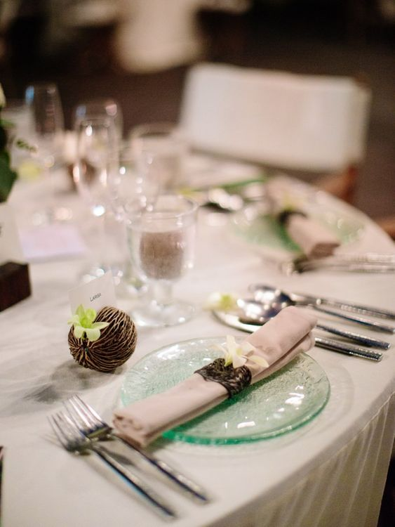Place setting with green glass plates and napkins