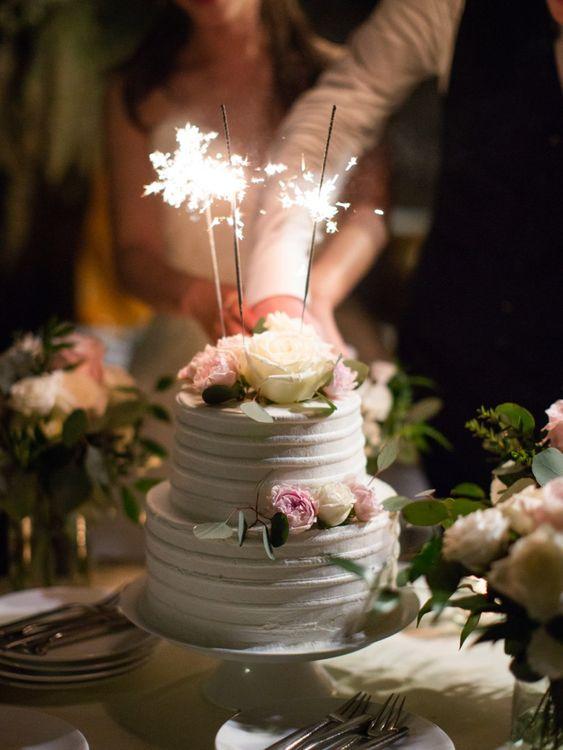 White wedding cake with sparkler topper
