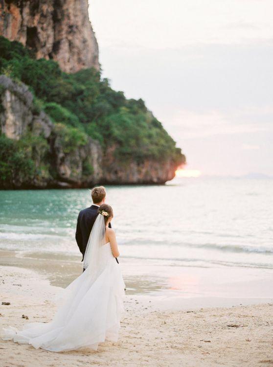Intimate wedding portrait on a Thailand beach for tropical wedding