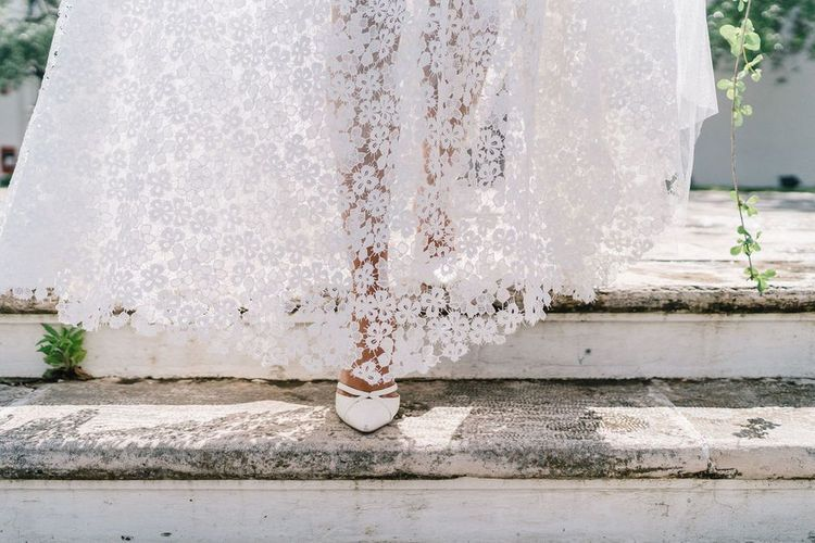 Bride in Lace Andrea Sedici Wedding Dress Walking Down the Steps