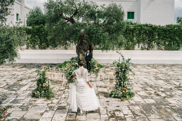 First Look with Bride in Lace Andrea Sedici Wedding Dress and Groom in Navy Suit