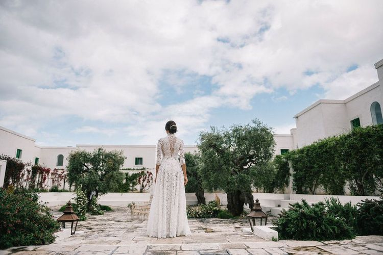 Bride in Lace Andrea Sedici Wedding Dress Standing at the Outdoor Ceremony