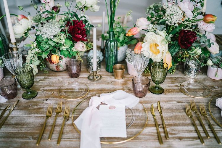 Elegant Place Setting with Glass Charger Plate and Gold Cutlery