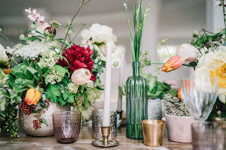 Colourful Wedding Flowers in Ceramic Vases with Candles