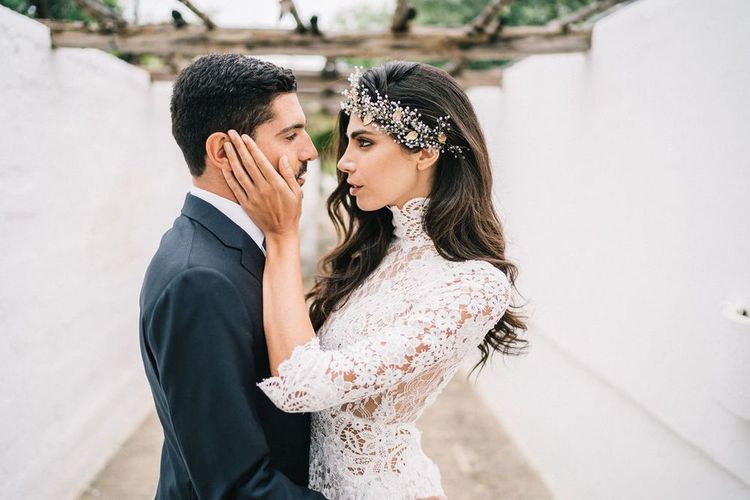 Bride in Lace three Quarter Sleeve Wedding Dress with Hair Vine and Groom in Dark Suit