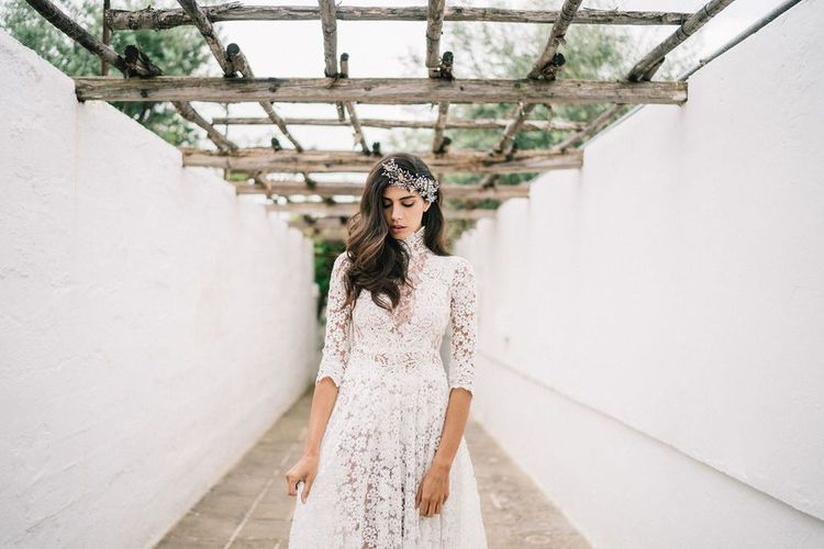 Bride in Lace Wedding Dress with High Neck and Three Quarter Sleeves