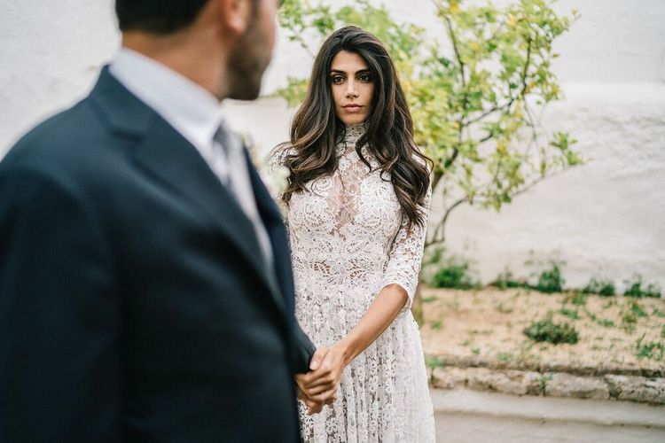 Bride in Lace Wedding Dress with Long Wavy Hair