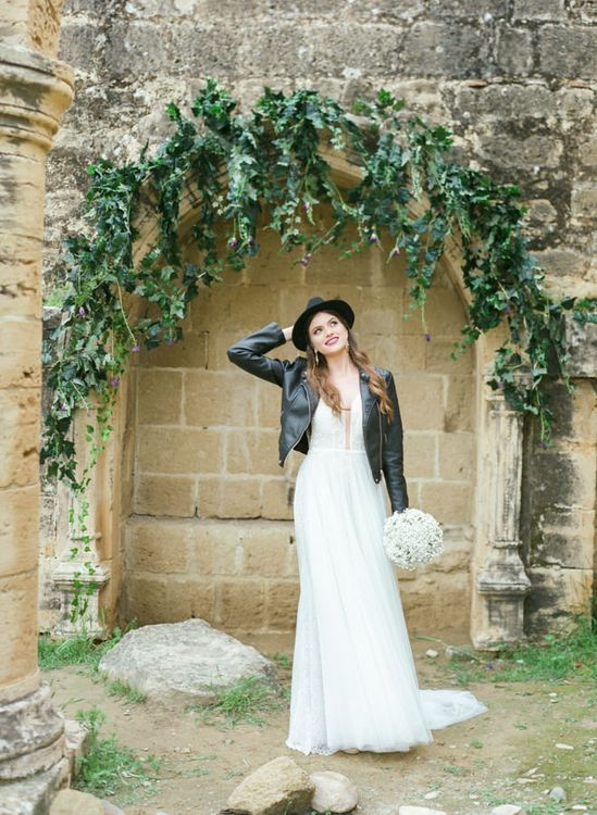 Bride in Sparkly Wedding Dress with Pure White Bouquet and Wearing a Leather Jacket and Fedora Hat