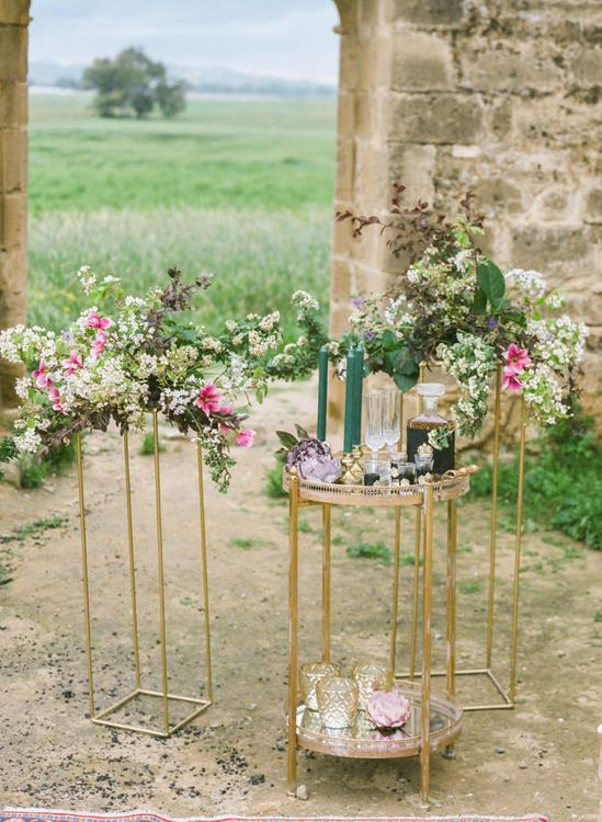 Gold Drinks Trolley and Stands Decorated with Romantic Wedding Flowers