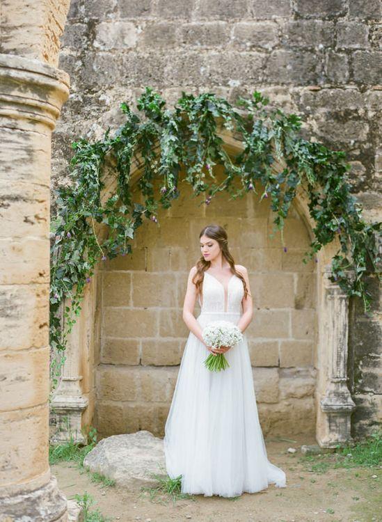 Bride in V Neck Wedding Dress