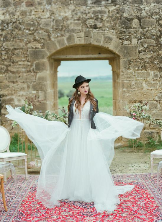 Bride in Sparkly Wedding Dress, Black Leather Jacket and Fedora Hat