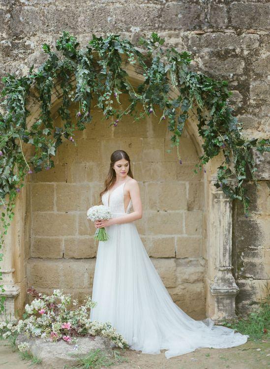 Bride in Sparkly Wedding Dress Holding a White Wedding Bouquet