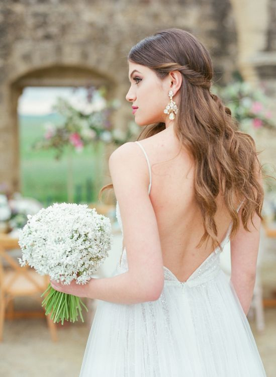 Bride with Twisted Half up Half Down Wedding Hair Showing off Low V Back Wedding Dress