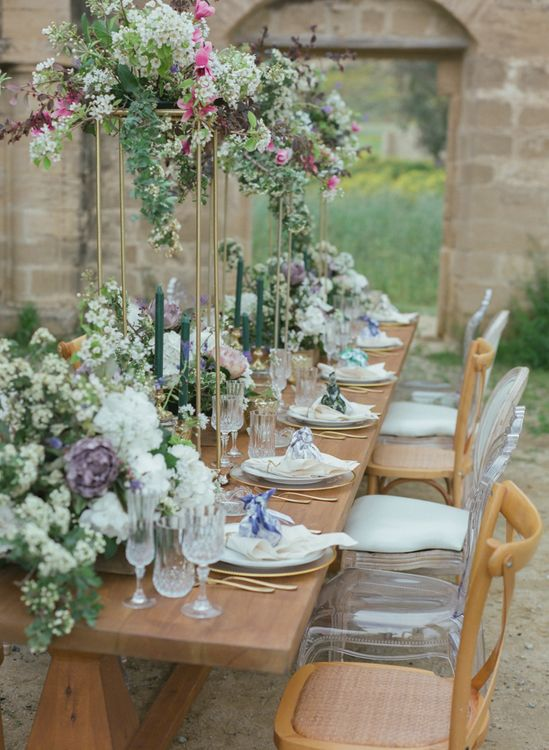 Romantic Table Decor with Cut Glass, White Purple & Green Wedding Flowers and Ghost Chairs