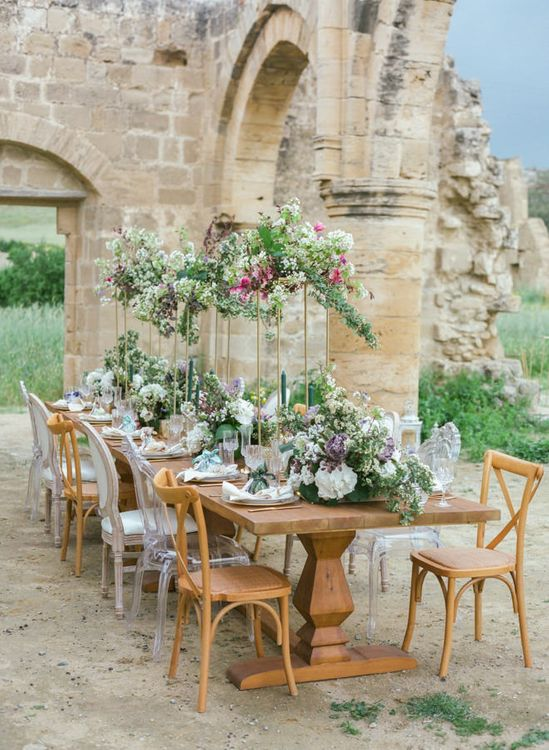 Wooden Tablescape with Ghost Chairs, High Copper Floral Arrangements and Cut Glass Tableware