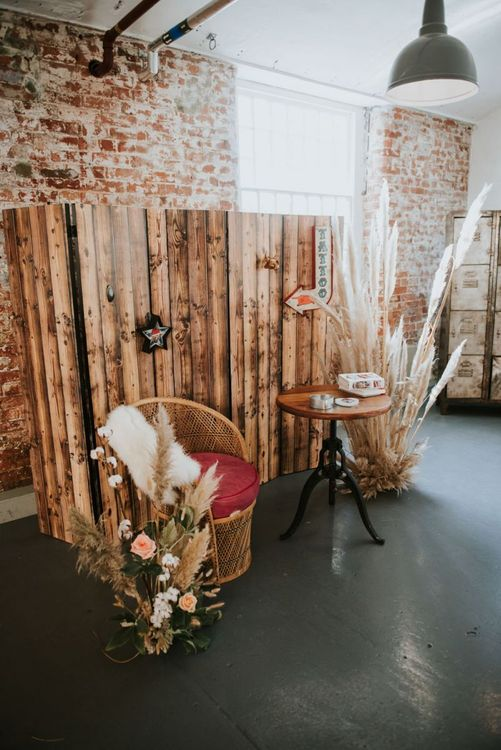 Tattoo parlour with wood screen and wicker chairs