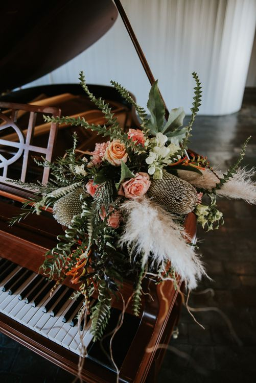 Bouquet with peach roses, foliage and pampas grass