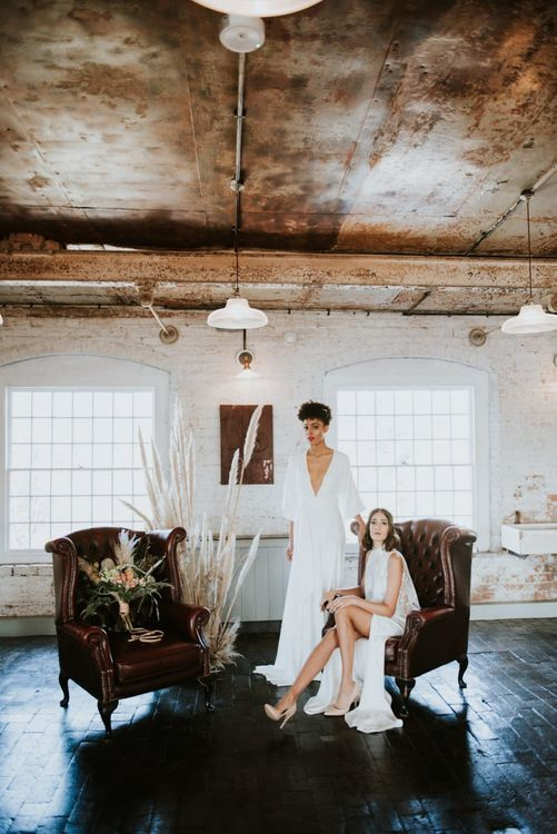 Two brides sitting in the chill out area at The West Mill