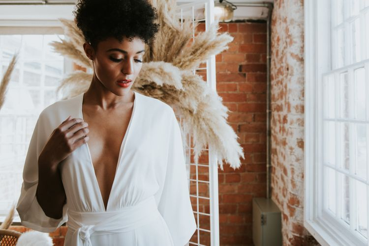 Bride with short curly hair in jumpsuit