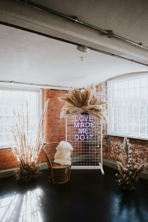 Love Made Me Do It neon wedding sign and pampas grass