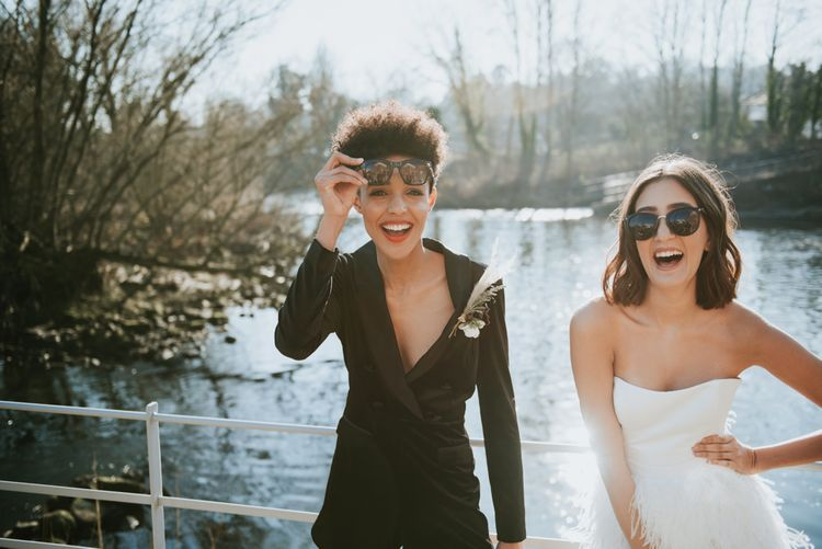 Brides wearing sunglasses at The West Mill wedding venue