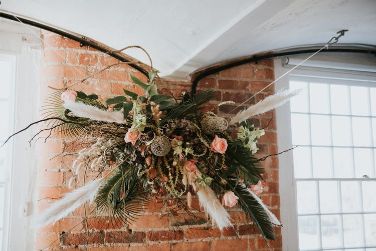 Flower installation with pampas grass, foliage and  roses
