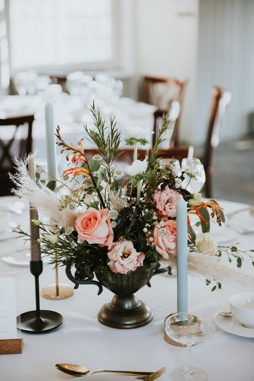 Floral table centrepiece with pink flowers, foliage and pampas grass