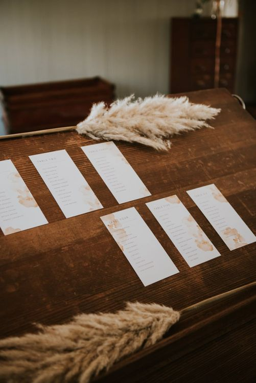 Wedding stationery designs with pampas grass  stems at The West Mill