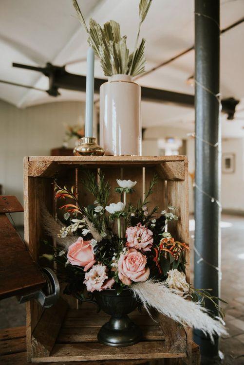 Wooden crate wedding decor with floral arrangement