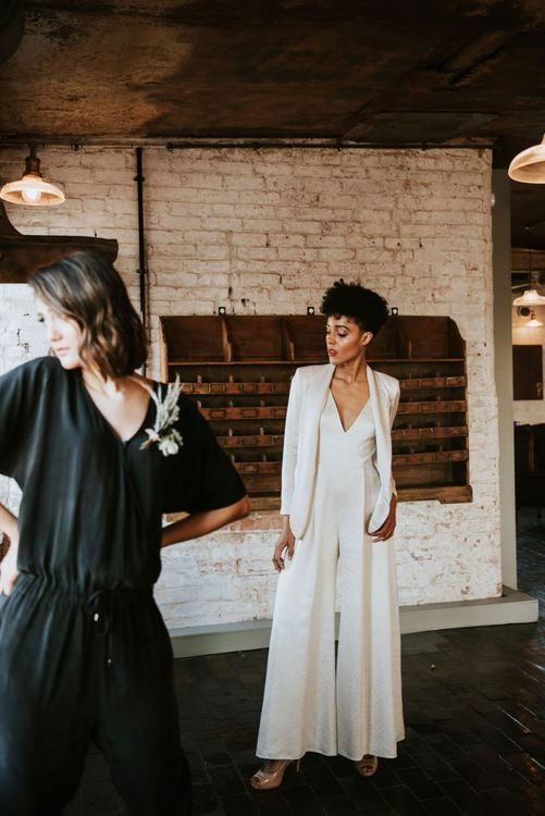 Bride in jumpsuit and jacket wedding suit at The West Mill