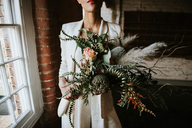 Oversized wild wedding bouquet with foliage and pampas grass