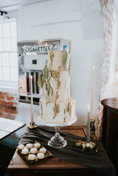 Wedding cake with geode detail and dried palm leaf at The West Mill wedding venue