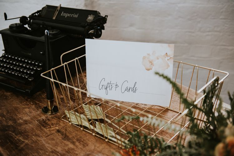 Typewriter and gold wire card box