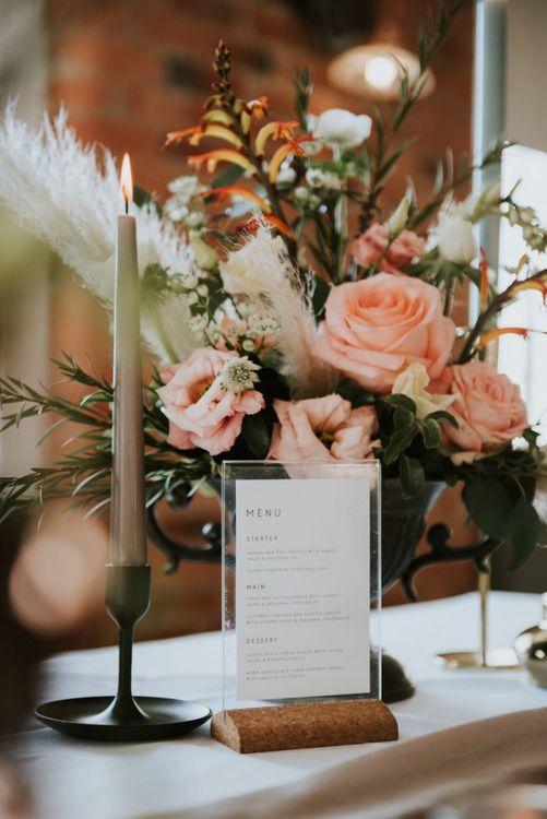 Acrylic menu frame and floral centrepiece