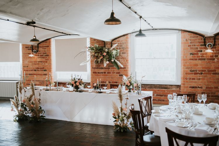 Top table wedding decor and flowers at The West Mill