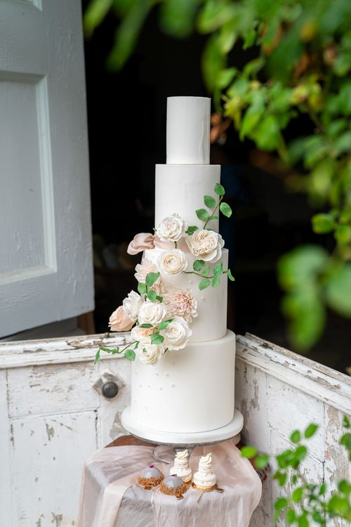 4 Tier White Wedding Cake by MonAnnie   Timeless Romance at Country House West Horsley Place, Surrey   Planned by Rachel Dalton Weddings   David Wheeler Photography