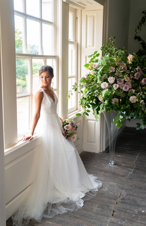Bride in Elegant Wedding Gown   Blush Rose Fireplace Floral Arrangement by Emma Soulsby Flowers   Timeless Romance at Country House West Horsley Place, Surrey   Planned by Rachel Dalton Weddings   David Wheeler Photography