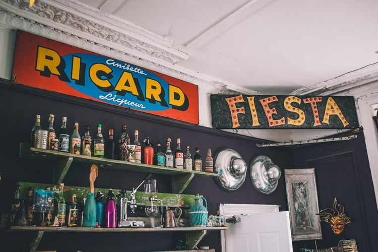 The Roost Dalston Wedding with vintage decor and colourful eclectic signage