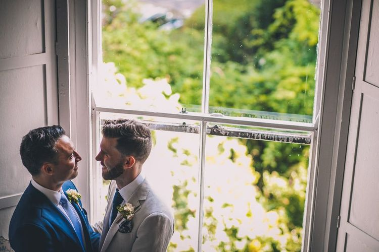The Roost Dalston same-sex wedding with vintage decor colourful signage and white blazer