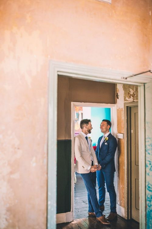 The Roost Dalston gay wedding with vintage decor and groom wearing a white blazer