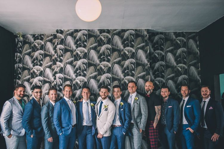 Party guests at intimate same-sex celebration in London with vintage decor and colourful styling