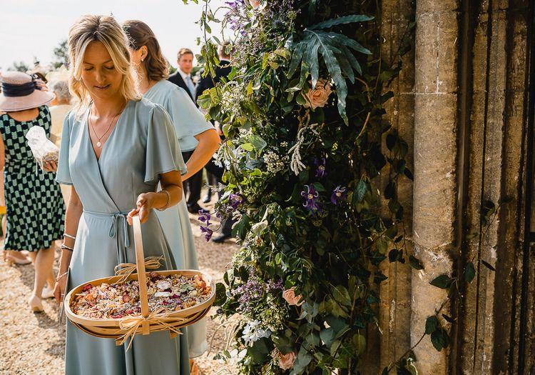 Dried Petal Confetti // Coastal Inspired Marquee Wedding With Bride In Bespoke Dress And Bridesmaids In Rewritten Wrap Dresses Images By Luis Holden