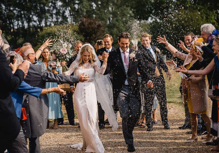 Confetti Shot // Coastal Inspired Marquee Wedding With Bride In Bespoke Dress And Bridesmaids In Rewritten Wrap Dresses Images By Luis Holden