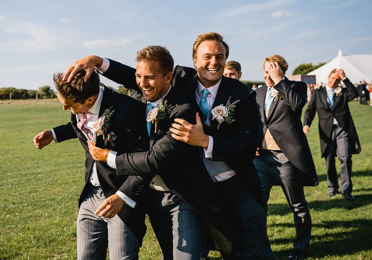 Groomsmen With Blue Ties For Wedding // Coastal Inspired Marquee Wedding With Bride In Bespoke Dress And Bridesmaids In Rewritten Wrap Dresses Images By Luis Holden