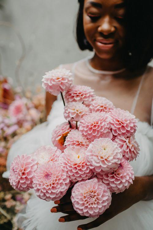 pink pompom dahlia bouquet for tropical wedding inspiration at Secret Garden Kent