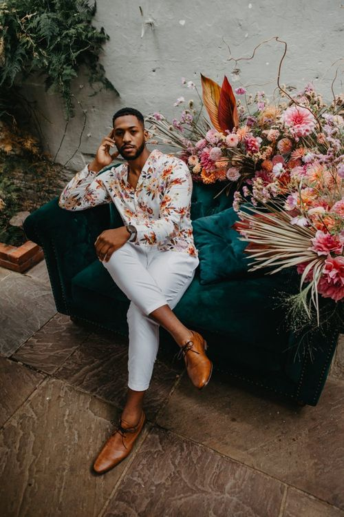 Groom in floral shirt and white trousers at Secret Garden Kent