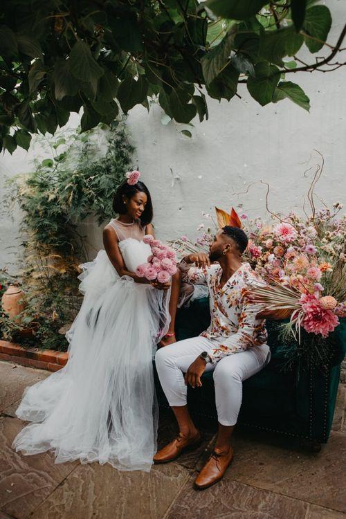 Bride and groom at tropical wedding inspiration at Secret Garden Kent