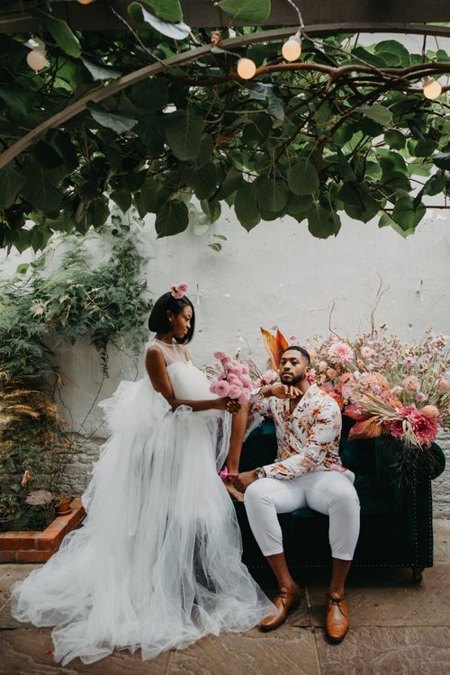 Bride in tulle wedding dress and groom floral shirt at tropical wedding inspiration